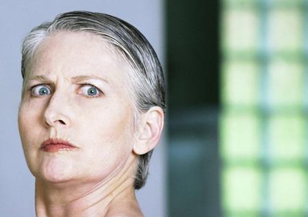 authoritative woman: Mature woman looking at camera, close-up, portrait
