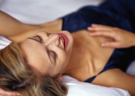 repose: Woman lying down, smiling