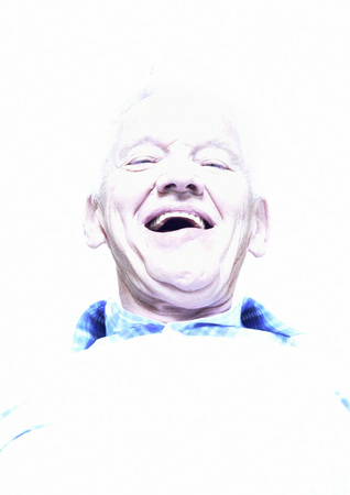Elderly man laughing, low angle view, portrait