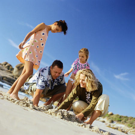 Family digging in sand