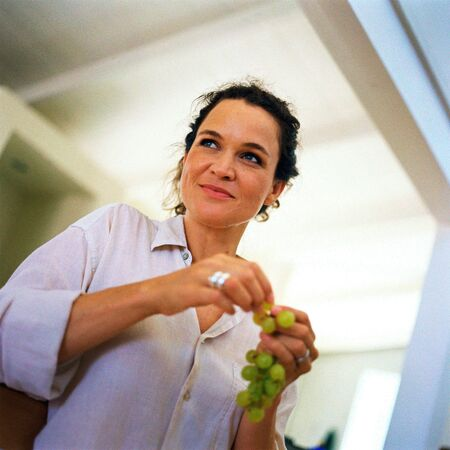 Woman holding grapes, low angle view LANG_EVOIMAGES
