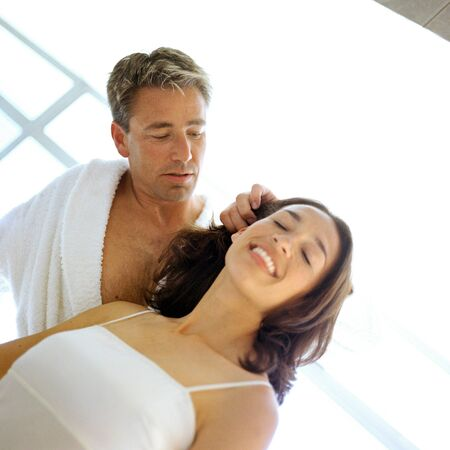 Man caressing womans hair