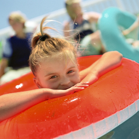 Girl in inflatable ring, smiling, close-up