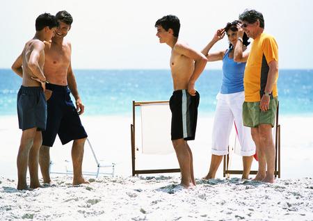 People standing on beach, talking