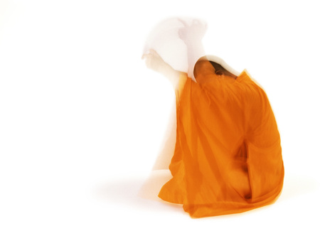 Buddhist monk meditating, side view, blurred motion