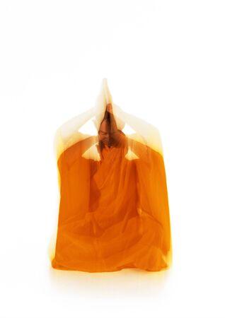 Buddhist monk meditating, blurred motion LANG_EVOIMAGES