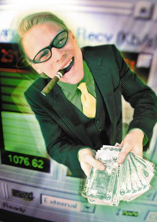 Businessman holding pile of cash, emerging from computer monitor, digital composite LANG_EVOIMAGES