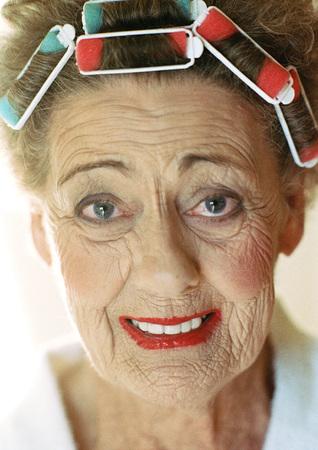 Senior woman looking into camera, portrait