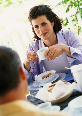 Woman and man having breakfast outside