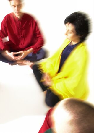 closed community: Group of people sitting on floor indian style, meditating, blurred LANG_EVOIMAGES