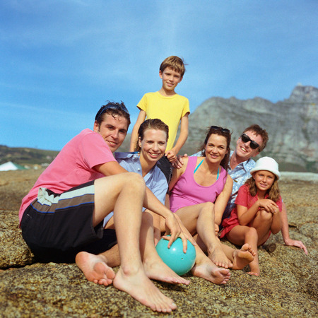 Two couples and children outside, smiling, portrait LANG_EVOIMAGES