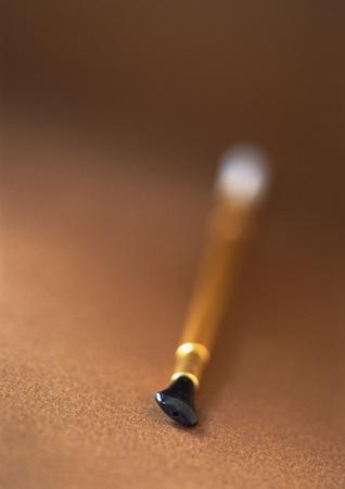 Cigarette holder, close-up, blurred LANG_EVOIMAGES