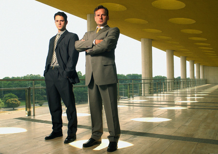Two businessmen looking into camera