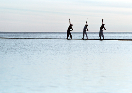 Three people exercising by the sea LANG_EVOIMAGES