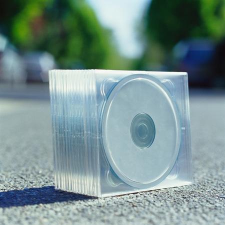 Pack of CDs on sidewalk