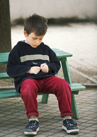 Child sitting on bench