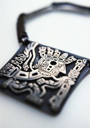 Carved silver amulet, close-up