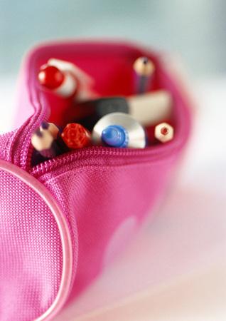 containing: Pencil case containing school supplies
