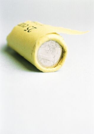 valued: Paper roll of euro coins LANG_EVOIMAGES