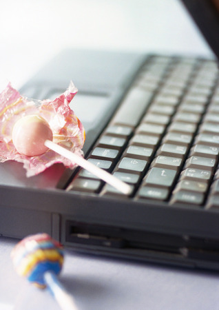 Laptop with lollipops, close-up