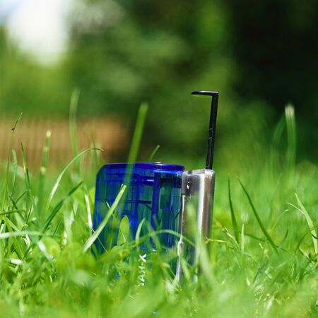 Hole puncher in grass, close-up