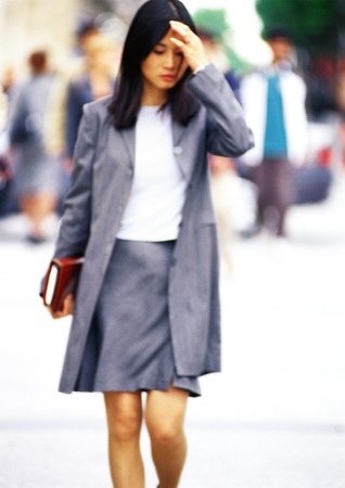 Businesswoman walking with book in hand
