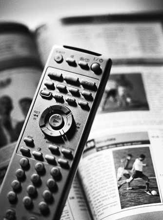 Remote control and tv program, close-up LANG_EVOIMAGES
