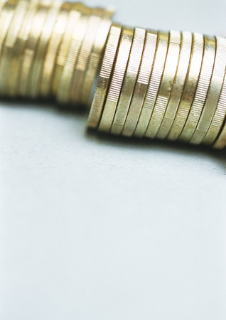 valued: Row of euro coins standing on edge, close-up LANG_EVOIMAGES
