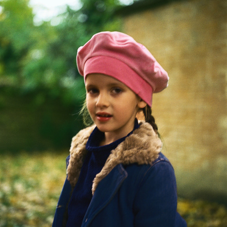 berets: Girl outside wearing pink beret, winter coat, looking at camera