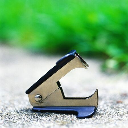 Staple remover on sidewalk LANG_EVOIMAGES