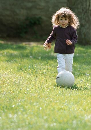 Child playing with soccer ball
