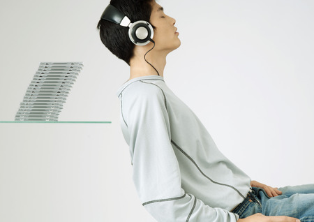Young man wearing headphone listening to music