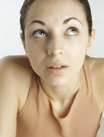 Woman looking up with raised eyebrows, close-up
