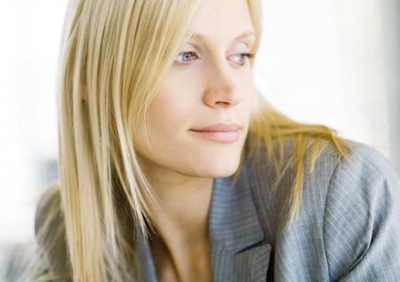 Blond businesswoman looking away, portrait