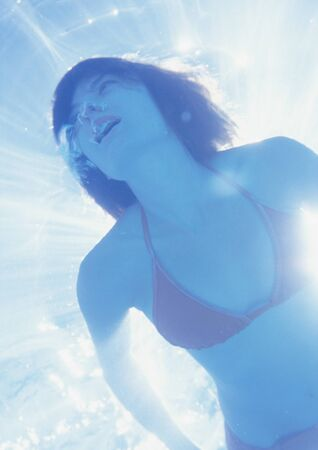Woman underwater, low angle view