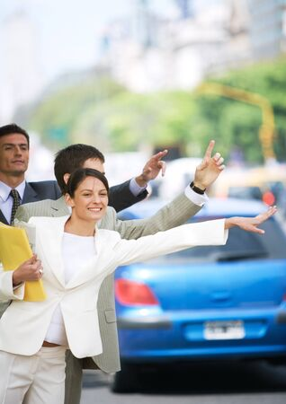 Businesspeople hailing cabs