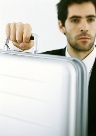 burned out: Man with stubble holding briefcase