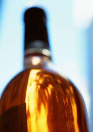 in low spirits: Bottle of white wine LANG_EVOIMAGES