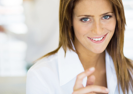 Woman smiling mischievously