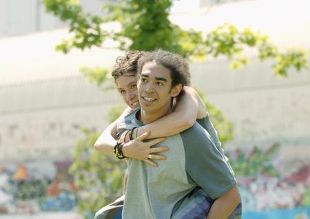 Man carrying young woman piggyback