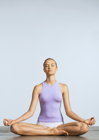 greased: Woman sitting on floor in lotus position