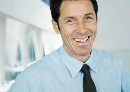 Businessman smiling at camera, portrait