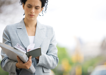 Businesswoman looking down at agenda