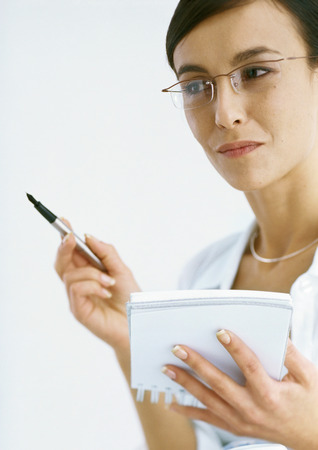 Woman holding notepad and pen
