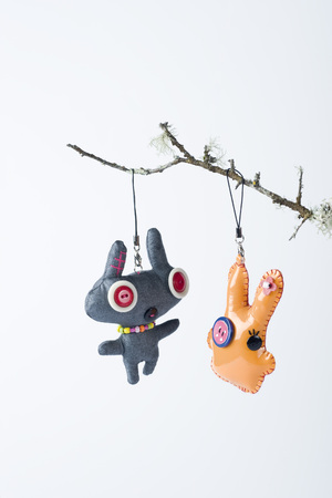 Dolls hanging from branch LANG_EVOIMAGES