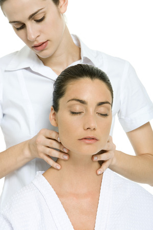 beauties: Massage therapist giving woman neck massage, eyes closed