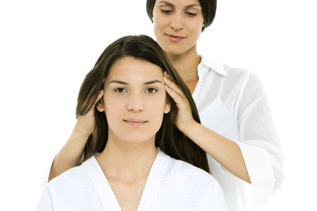 Woman receiving head massage, looking at camera