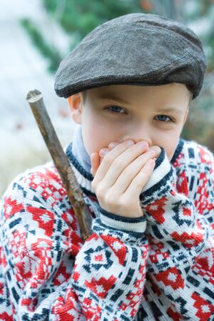 berets: Boy warming hands, portrait