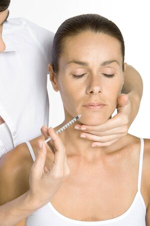 oneself: Woman receiving collagen injection, eyes closed