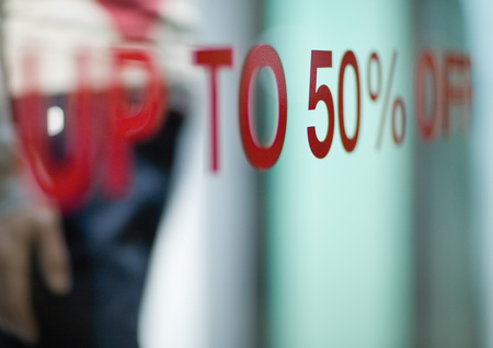 Up to 50% off text on shop window